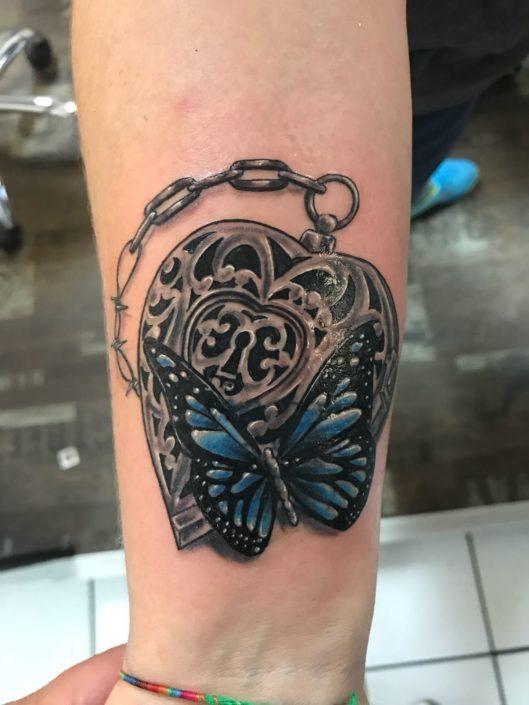Schmetterling Herz Tattoo
